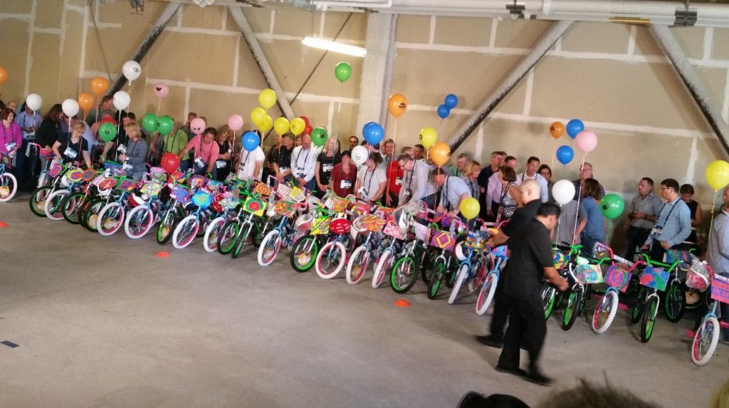 Sedgwick leadership teambuilding 'Caring Counts' activity building bikes to donate to The Boys and Girls Club.